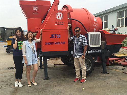 Indonesia customer visit our trailer pump factory to check his ordered Concrete Mixer with pump